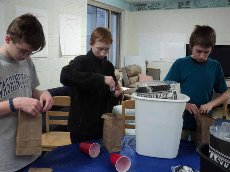 Christ Episcopal Church teens making Luminarias - part of our community outreach
