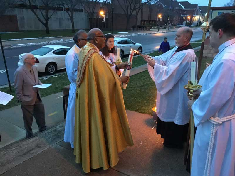The New Fire of the Year was celebrated on the front steps with the lighting of the Paschal Candle during Easter Vigil.