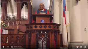 Father Patrick in Pulpit